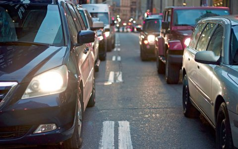 Cars sit in traffic on a two-lane road