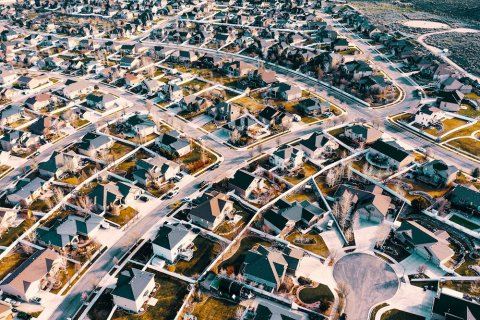 Aerial shot of a subdivision with houses and trees